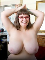 Mature plumper in glasses revealing her hairy pits and cunt